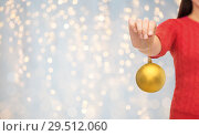 Купить «close up of woman in sweater with christmas ball», фото № 29512060, снято 10 сентября 2014 г. (c) Syda Productions / Фотобанк Лори