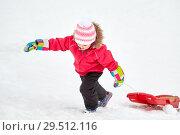 Купить «girl with sled climbing snow hill in winter», фото № 29512116, снято 10 февраля 2018 г. (c) Syda Productions / Фотобанк Лори