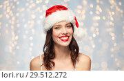 Купить «woman with red lipstick in santa hat on christmas», фото № 29512272, снято 5 января 2018 г. (c) Syda Productions / Фотобанк Лори