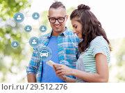 Купить «happy couple using car sharing app on smartphone», фото № 29512276, снято 10 июня 2018 г. (c) Syda Productions / Фотобанк Лори