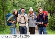 Купить «friends or travelers hiking with backpacks and map», фото № 29512296, снято 31 августа 2014 г. (c) Syda Productions / Фотобанк Лори