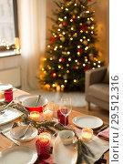 Купить «table served for christmas dinner at home», фото № 29512316, снято 14 декабря 2017 г. (c) Syda Productions / Фотобанк Лори