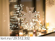 Купить «paper snowflake decoration hanging on window», фото № 29512332, снято 11 января 2018 г. (c) Syda Productions / Фотобанк Лори