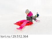 Купить «happy little girl sliding down on sled in winter», фото № 29512364, снято 10 февраля 2018 г. (c) Syda Productions / Фотобанк Лори