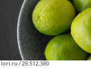 Купить «close up of whole limes in bowl», фото № 29512380, снято 4 апреля 2018 г. (c) Syda Productions / Фотобанк Лори