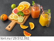 mason jar glass with juice and fruits on table. Стоковое фото, фотограф Syda Productions / Фотобанк Лори