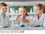 Купить «kids with test tube studying chemistry at school», фото № 29512408, снято 19 мая 2018 г. (c) Syda Productions / Фотобанк Лори