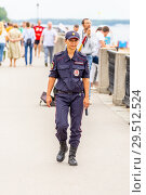 Купить «Russia, Samara, June 2018: a police woman walks along the embankment of the Volga River», фото № 29512524, снято 22 июля 2018 г. (c) Акиньшин Владимир / Фотобанк Лори