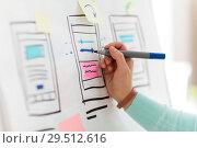 Купить «ui designer working on user interface at office», фото № 29512616, снято 5 февраля 2018 г. (c) Syda Productions / Фотобанк Лори