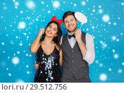 Купить «happy couple with party props having fun», фото № 29512756, снято 15 декабря 2017 г. (c) Syda Productions / Фотобанк Лори
