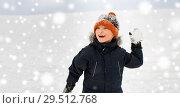 Купить «happy boy playing and throwing snowball in winter», фото № 29512768, снято 10 февраля 2018 г. (c) Syda Productions / Фотобанк Лори