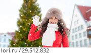 Купить «happy woman over christmas tree in tallinn», фото № 29512832, снято 7 января 2017 г. (c) Syda Productions / Фотобанк Лори