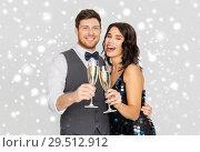 Купить «happy couple with champagne celebrating christmas», фото № 29512912, снято 15 декабря 2017 г. (c) Syda Productions / Фотобанк Лори
