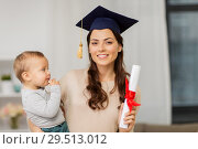 Купить «mother student with baby boy and diploma at home», фото № 29513012, снято 1 декабря 2017 г. (c) Syda Productions / Фотобанк Лори