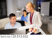 Купить «business team with papers working late at office», фото № 29513032, снято 6 декабря 2017 г. (c) Syda Productions / Фотобанк Лори