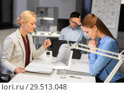 Купить «business team with laptop working late at office», фото № 29513048, снято 6 декабря 2017 г. (c) Syda Productions / Фотобанк Лори