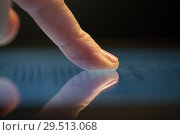 Купить «close up of hand using computer touch screen», фото № 29513068, снято 3 января 2018 г. (c) Syda Productions / Фотобанк Лори