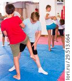 Купить «Kids exercising self-defense movements», фото № 29513664, снято 6 августа 2018 г. (c) Яков Филимонов / Фотобанк Лори