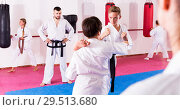 Купить «Children working in pair mastering new karate moves», фото № 29513680, снято 23 марта 2019 г. (c) Яков Филимонов / Фотобанк Лори