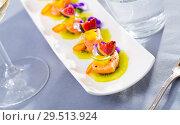 Купить «Pickled salmon on kiwi with figs, mango, kumquat», фото № 29513924, снято 15 ноября 2019 г. (c) Яков Филимонов / Фотобанк Лори