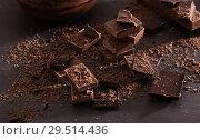 Купить «chocolate on old wooden table», фото № 29514436, снято 22 января 2018 г. (c) Майя Крученкова / Фотобанк Лори
