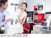 Купить «Couple choosing mixer tap», фото № 29523108, снято 15 июня 2017 г. (c) Яков Филимонов / Фотобанк Лори