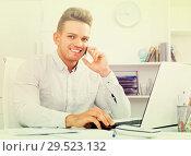 Купить «Business partner with smart phone and laptop», фото № 29523132, снято 14 декабря 2019 г. (c) Яков Филимонов / Фотобанк Лори