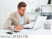 Купить «Portrait of businessman working in modern office», фото № 29523136, снято 14 декабря 2019 г. (c) Яков Филимонов / Фотобанк Лори