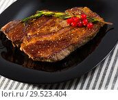 Купить «Roasted beef steak with rosemary and redcurrant», фото № 29523404, снято 29 июня 2018 г. (c) Яков Филимонов / Фотобанк Лори