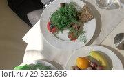 Купить «A top view of three plates with healthy food», видеоролик № 29523636, снято 16 января 2019 г. (c) Данил Руденко / Фотобанк Лори