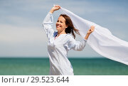 Купить «happy woman with shawl waving in wind on beach», фото № 29523644, снято 15 июня 2018 г. (c) Syda Productions / Фотобанк Лори
