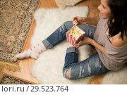 Купить «happy woman eating popcorn at home», фото № 29523764, снято 13 января 2018 г. (c) Syda Productions / Фотобанк Лори