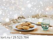Купить «oatmeal cookies and candle in holder at home», фото № 29523784, снято 15 ноября 2017 г. (c) Syda Productions / Фотобанк Лори