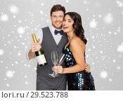 Купить «happy couple with champagne celebrating christmas», фото № 29523788, снято 15 декабря 2017 г. (c) Syda Productions / Фотобанк Лори