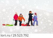 Купить «happy little kids with sleds in winter», фото № 29523792, снято 10 февраля 2018 г. (c) Syda Productions / Фотобанк Лори