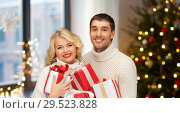 Купить «happy couple with christmas gifts at home», фото № 29523828, снято 7 октября 2012 г. (c) Syda Productions / Фотобанк Лори