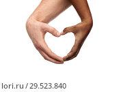 Купить «hands of different skin color making heart shape», фото № 29523840, снято 12 декабря 2013 г. (c) Syda Productions / Фотобанк Лори
