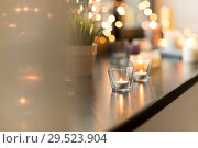 Купить «candles burning on window sill with garland lights», фото № 29523904, снято 13 января 2018 г. (c) Syda Productions / Фотобанк Лори