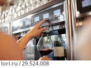 Купить «close up of woman with glass at wine dispenser», фото № 29524008, снято 25 июня 2018 г. (c) Syda Productions / Фотобанк Лори