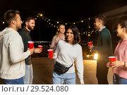 Купить «friends with drinks dancing at rooftop party», фото № 29524080, снято 2 сентября 2018 г. (c) Syda Productions / Фотобанк Лори