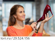 Купить «happy young woman choosing shoes at store», фото № 29524156, снято 22 сентября 2017 г. (c) Syda Productions / Фотобанк Лори
