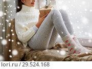 Купить «girl with christmas gift sitting on sill at home», фото № 29524168, снято 5 ноября 2016 г. (c) Syda Productions / Фотобанк Лори