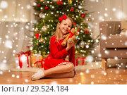 Купить «girl in red dress hugging teddy bear at home», фото № 29524184, снято 22 декабря 2017 г. (c) Syda Productions / Фотобанк Лори