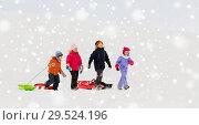 Купить «happy little kids with sleds in winter», фото № 29524196, снято 10 февраля 2018 г. (c) Syda Productions / Фотобанк Лори