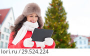 Купить «woman with tablet pc over christmas tree», фото № 29524224, снято 7 января 2017 г. (c) Syda Productions / Фотобанк Лори