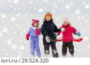 Купить «happy little kids playing outdoors in winter», фото № 29524320, снято 10 февраля 2018 г. (c) Syda Productions / Фотобанк Лори