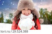 Купить «woman in fur hat with snow over winter forest», фото № 29524388, снято 7 января 2017 г. (c) Syda Productions / Фотобанк Лори