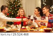Купить «happy friends drinking red wine at christmas party», фото № 29524468, снято 17 декабря 2017 г. (c) Syda Productions / Фотобанк Лори