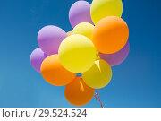 Купить «close up of colorful helium balloons in blue sky», фото № 29524524, снято 29 мая 2018 г. (c) Syda Productions / Фотобанк Лори