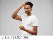 Купить «indian man applying hair wax or styling gel», фото № 29524568, снято 27 октября 2018 г. (c) Syda Productions / Фотобанк Лори